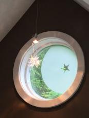 Beautiful Swarovski pendant incorporated with moon and star window.