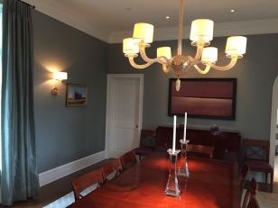 Decorative table fixture and accent wall sconce work well with the low volt recessed lighting.