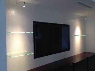 Tech Lighting wall mounted display lights using LED lamps. Floating glass shelves backlight using linear LED's.