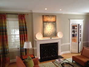 Low volt recessed lighting to illuminate art work over fireplace