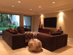 Recessed lighting used as main lighting in living room.